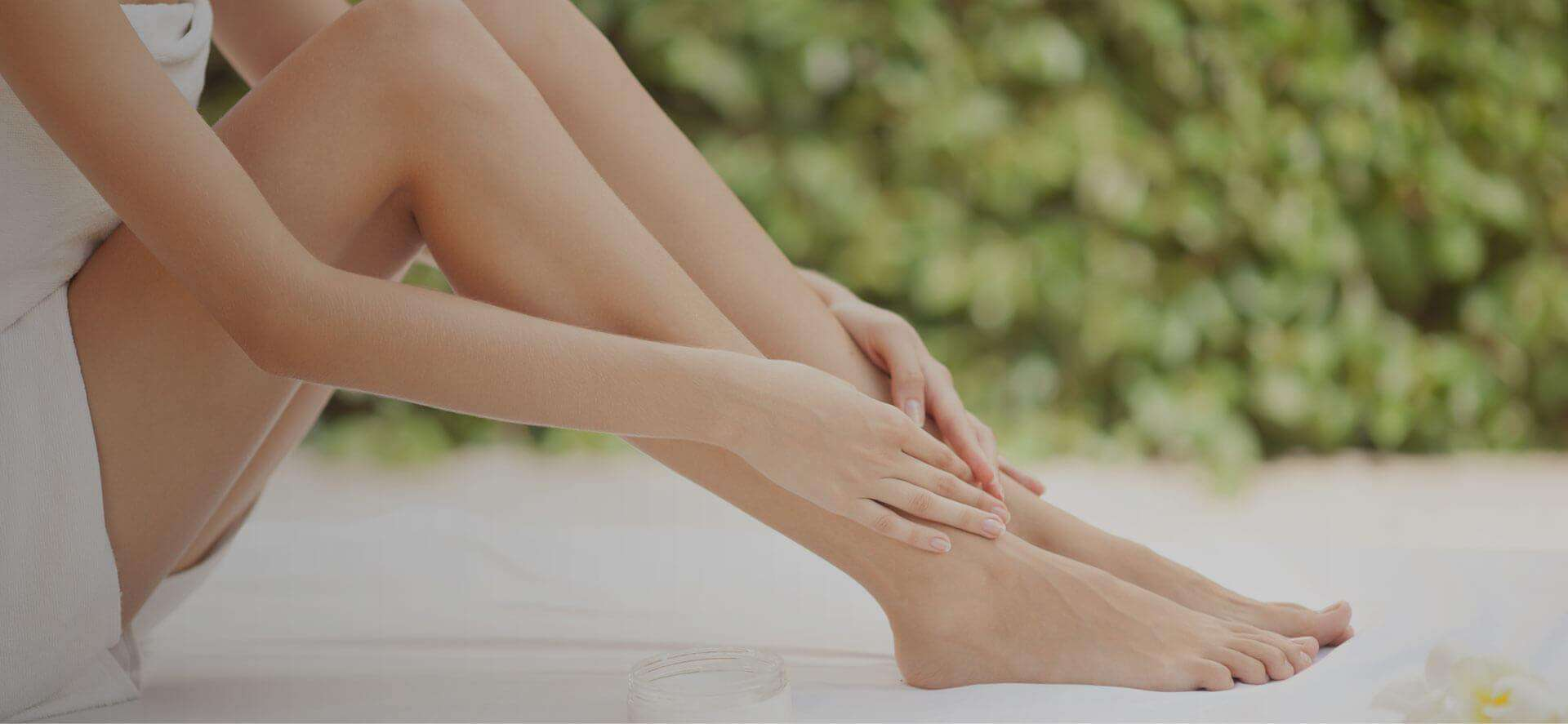 Woman enjoying smooth legs after non-invasive varicose vein treatment.